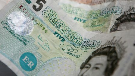 File photo of five and ten pound notes. Picture: Gareth Fuller/PA Wire