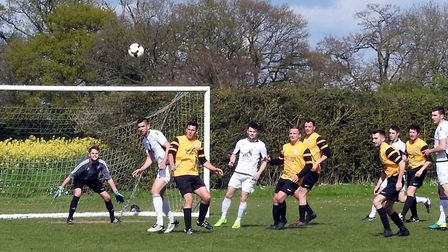 Beccles on the front foot duirng Saturday's crunch match against Scole. Picture: John Walters