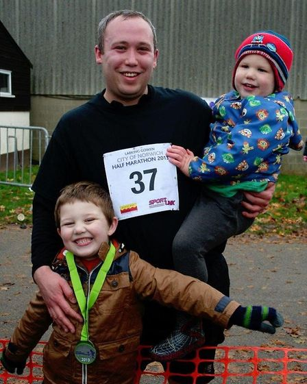 Liam Corcoran with his sons Oscar, eight, and Leo, six. Mr Corcoran is running the marathon for Norw