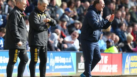 Simon Grayson attempts to get his Preston side going as Norwich's Frankie McAvoy and Alan Irvine loo