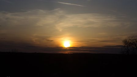 The sun setting over Thetford. Capture by photographer Kevin Gorman from the top of the Iron Age hil