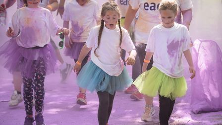 Participants face the paint at last year's Colour Dash at Eaton Park in Norwich in aid of EACH. Pict