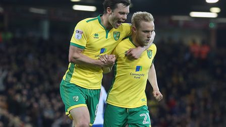 Jonny Howson, left, congratulates Alex Pritchard for his part in putting City 2-0 ahead against Brig