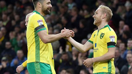 Russell Martin, who made his 300th appearance for Norwich City, congratulates Alex Pritchard (right)