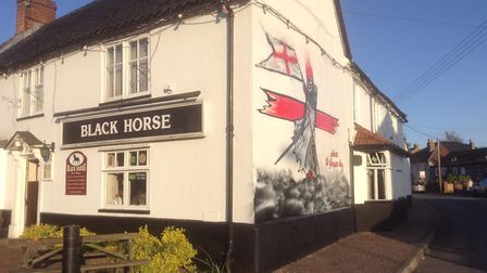 The St George's Day mural on the side of the Black Horse pub in Thetford, by Lee Stroble. Picture: C
