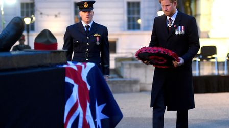 Prince Harry lays a wreath during an Anzac Day service in London last year. Picture: PA