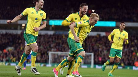 Alex Pritchard takes the celebrations after instigating Norwich City's second goal against Brighton