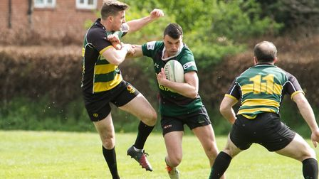 Ethan Benney powers forward during North Walsham's final league game of the season. Picture: Hywel J