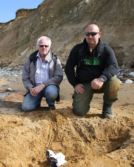 Amateur archaeologists Dan Chamberlain and Russell Yeomans at the spot on the beach where they made