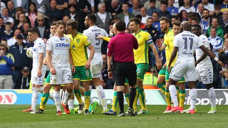 Tempers flare after Graham Dorrans of Norwich and Gaetano Berardi of Leeds United clash during the S