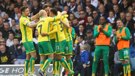 NCFC team members hug as Nelson Oliveira of Norwich celebrates scoring his sides 2nd goal during the