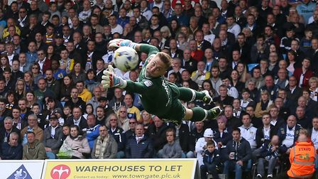 Rob Green of Leeds United dives to reach a shot on goal by Nelson Oliveira of Norwich during the Sky