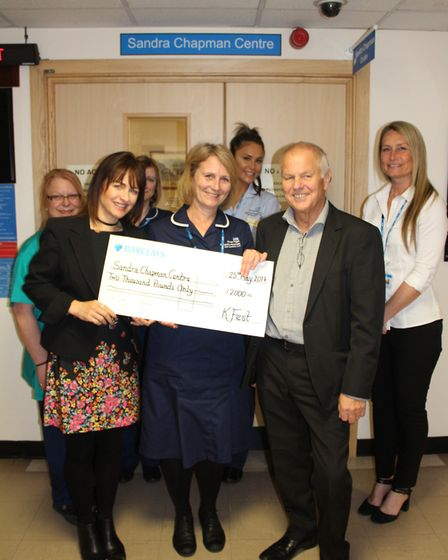 Roy Down and Clare Chenery-Down presenting a cheque to staff from the Sandra Chapman Centre. Picture