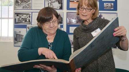 Member Joyce Torrice (left) and secretary of the Docking Heritage Group, Helena Aldis look at a 188