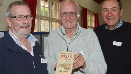 Wells Local History Group chairman, Mike Welland holds the 1894 copy of the Wells town guide illustr