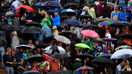 Umbrellas were up as rain stopped play ay Wimbledon, last years.... but how many spectators left the