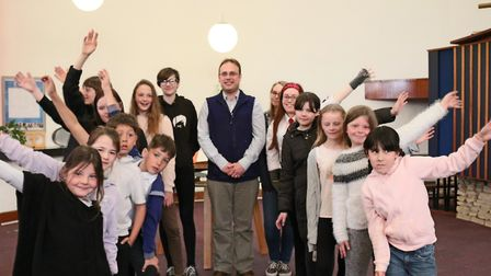 Members of Singing Futures with Joe Knight, who wrote a musical for them to perform.