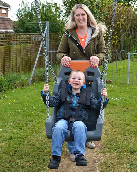 Riley Slater, aged six, enjoying the new swing with his mum Julie. Picture: Mick Howes.