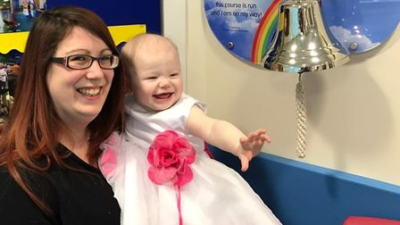 Lavinia Crosbie along with her mother Lucy rings the bell at Addenbrooke's Hospital in Cambridge, wh