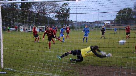 Cromer goalkeeper Liam Davies kept the score down with a string of super saves. Picture: Ally McGilv