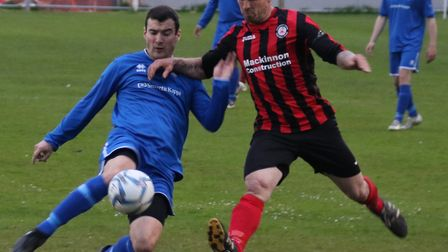 Cromer's Antoni Fawkes puts some pressure on the Harleston defence. Picture: Ally McGilvray