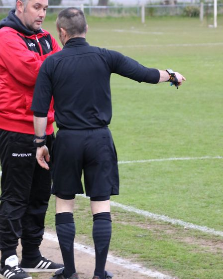 Cromer manager Lee Hackleton, pictured being given a warning by the referee, announced his resignati