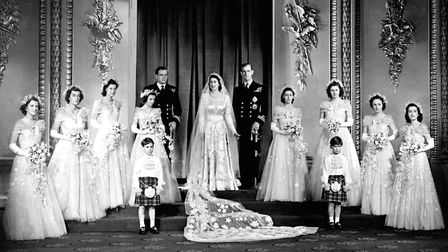 The couple with their eight bridesmaids in the Throne Room at Buckingham Palace, on their wedding da