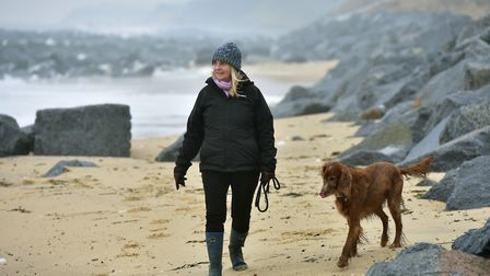 Valerie McGee with her dog Rudey who found £50 million of cocaine on Hopton beach. PHOTO: Nick Butc
