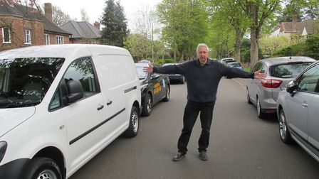 Chris Dunn shows how parking narrows the route through Wellesley Avenue South and Cintra Road. Pic:
