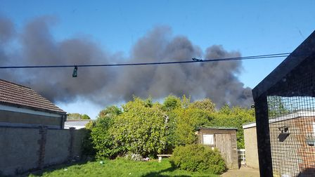 The smoke from silage on fire in Horsford this evening (Wednesday, May 10). Photo: submitted.
