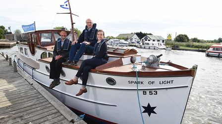 Herbert Woods' restored boat Spark of Light. Left to right, John Packman (The Broads Authority chief
