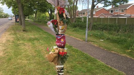 Tributes left at the scene of a crash on Caister Road. Picture: Archant