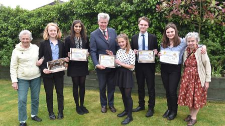 Students from Wymomdham High School receive their certificates for taking part in a befriending sche