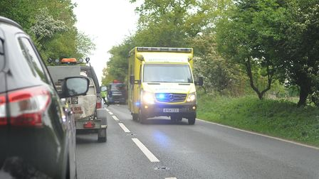 An ambulance leaving the scene of the crash. Picture: Chris Bishop