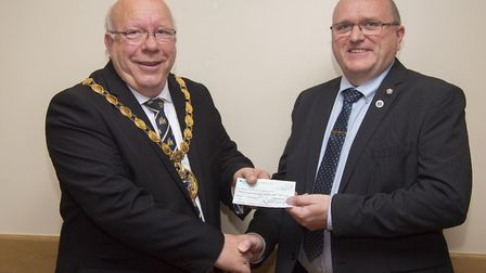 Former West Norfolk mayor David Whitby presented with a cheque for £310 for The Lavender Hill Mob by