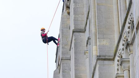 Daredevils abseiling down Norwich Castle for Cancer Research UK. PHOTO BY SIMON FINLAY