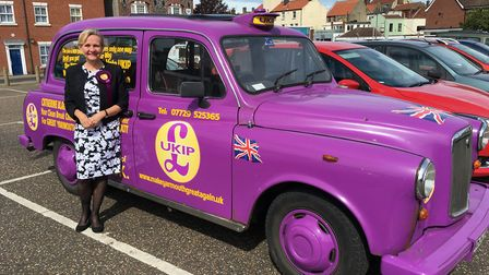 Catherine Blaiklock, UKIP parliamentary candidate for Great Yarmouth, posing with her campaign cab.