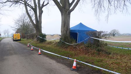 A police cordon at Church Road, Hardingham where a bag of bloodstained items was dumped. This provid