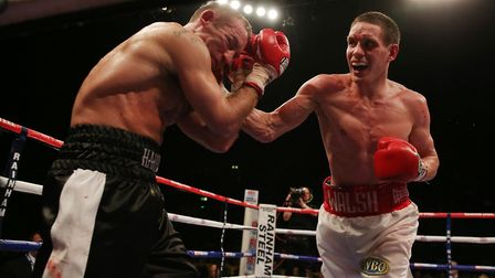 Liam Walsh on his way to victory over Scott Harrison. Picture: PA