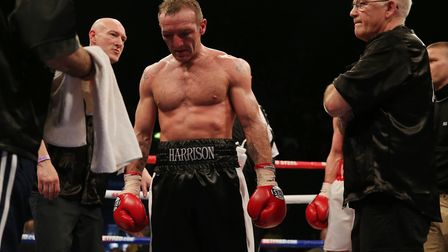 Scott Harrison stands dejected after losing to Liam Walsh. Picture: PA