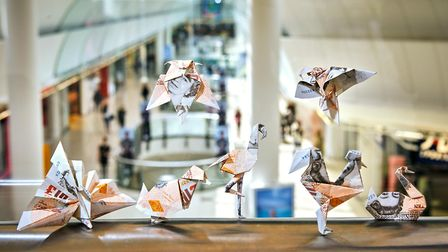Origami birds worth thousands of pounds have been folded and set free across 14 intu shopping centre