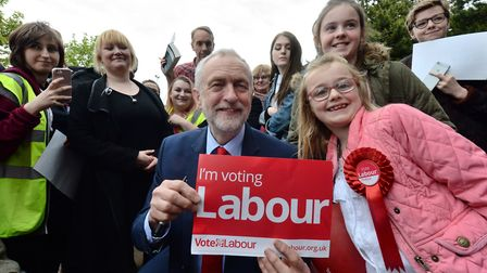 Labour leader Jeremy Corbyn with local supporters Laila Walker, seven, (right) and her sister Grace,