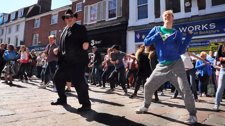 Stevan Gurney, executive director of Norwich BID, takes part in a flashmob at Gentleman's Walk, to l