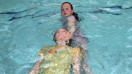 Eleven-year-old Mia Clarke demonstrates an extended arm tow on fellow Rookie Lifeguard course member
