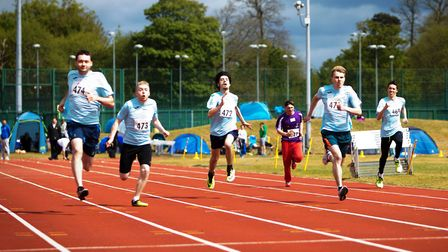 Joe Silom, left, winning the men's 100m from Cameron Ross and John Young, second right. Picture: Mic