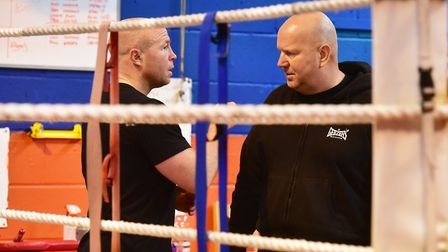 Graham Everett, right, talking tactics with Jon Thaxton at the Kickstop Gym. Picture: Nick Butcher