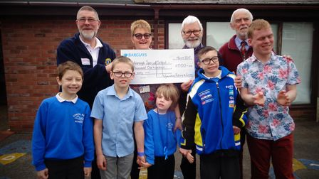 The Rotary Club of Wymondham and the Wymondham Lions hand over a cheque for �1,100 to Attleborough's