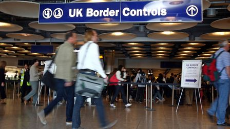 Border control in Terminal Five of London's Heathrow Airport. Picture: Steve Parsons/PA Wire.