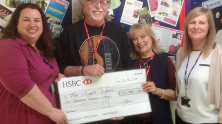 Barry Holden and his wife Chris presenting a �10,000 cheque to the Clare School's deputy head Rebec