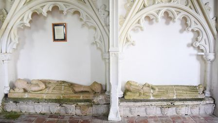 The effigies of a medieval knight and his wife, both originally clutching stone hearts as hers has b